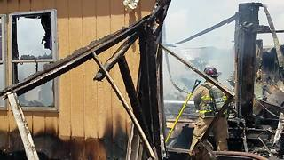 Rural Metro firefighters battle mobile home fire