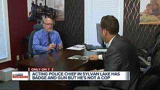 Local Acting Police Chief faces questions about carrying a gun and badge - Video