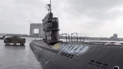 Urban explorers investigate abandoned 1950s Soviet submarine left to rot in a dock for 16 years