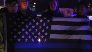 Police candlelight vigil brings out hundreds - Video