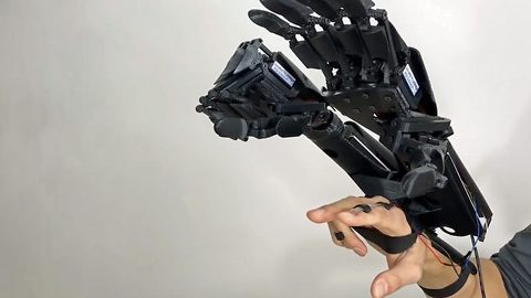 Because two hands are better than one: Daring inventor creates world's first double bionic hand, hoping to give the everyday man 'super-human abilities'
