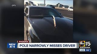 Pole narrowly misses driver on Loop 202 - Video