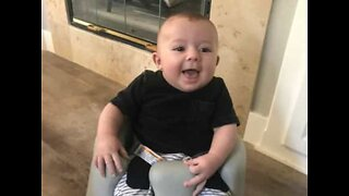 Baby rides a Roomba