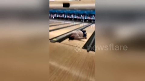 Hilarious moment US woman falls over while bowling