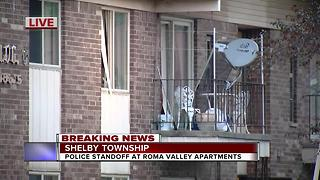 Man armed with butcher knives barricaded in metro Detroit apartment - Video