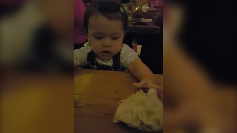 A Cute Tot Plays with Dough in A Restaurant