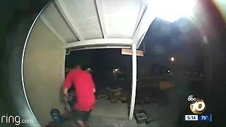 Man caught on camera tampering with family's water - Video