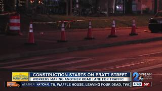 Construction underway on third lane along Pratt St. - Video