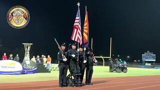 Paralyzed Peoria police officer stands for National Anthem