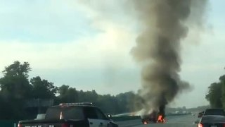 Truck catches fire after flipping over median wall on I-75 - Video
