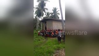 Locals carry home when owner wants to move 50 metres - Video