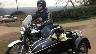 This Kevlar Wearing Dog Loves to Ride in Sidecar - Video