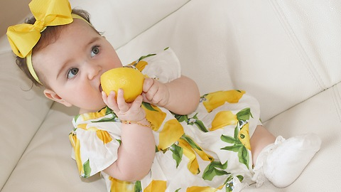 Baby tasting lemon for the first time