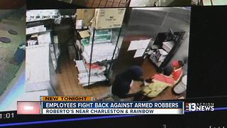 Employees fight back against armed robbers - Video