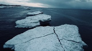 Aerial Footage Captures Lake Michigan Icebergs and Lighthouse - Video