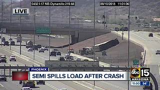 Beer kegs spill onto I-17 during truck rollover - Video