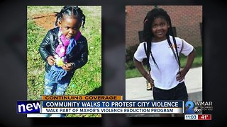 Community walks to rally against violence