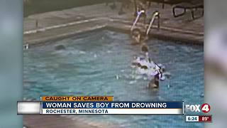 Woman saves boy from drowning - Video