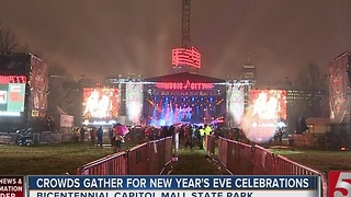 Crowds Gather For New Year's Eve Celebrations - Video