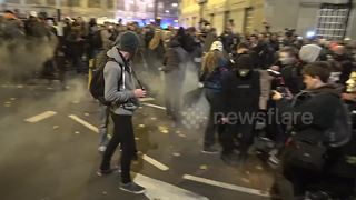 Arrests and firework injures man at Million Mask March in London - Video