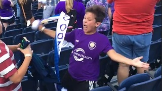 Kid goes crazy at MLS game after Orlando City scores goal - Video