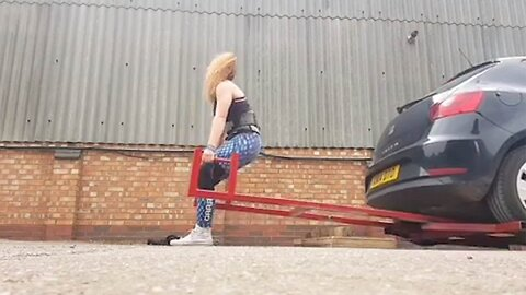 SLENDER DISABILITY NURSE BECOMES ENGLAND'S STRONGEST WOMAN USING UNIQUE TRAINING METHODS LIKE LIFTING VAUXHALL CORSA
