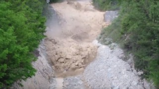 Violent Stream of Mud and Debris Flows Down Illhorn Mountain - Video
