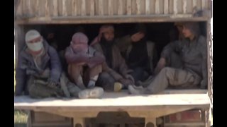 SDF Trucks Take Hundreds Out of Islamic State Enclave - Video