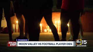 High school football player collapses on field, later dies - Video