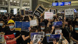Anti-Extradition Bill Protesters Occupy Hong Kong Airport