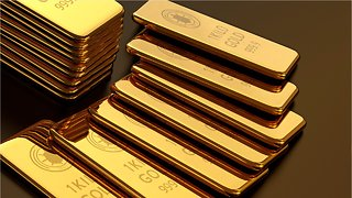 Gold Trades Up While Dollar Recedes