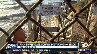Police investigate woman's body found on beach