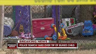 Police search yard over tip of buried child - Video