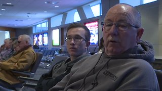 People react to the government shutdown at the Boise Airport