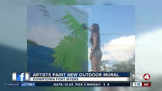 Artists paint new outdoor mural - Video