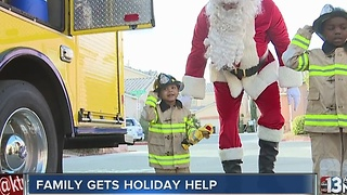 Young fire victims receive presents from fire department - Video