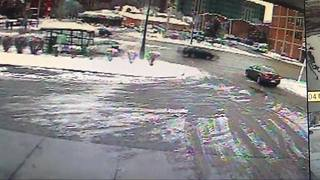 Three injured when car slams into bus stop - Video