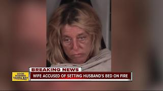 Woman arrested for attempted murder after intentionally setting husbands bed on fire as he slept - Video