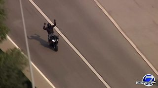 Motorcyclist caught on camera driving erratically through Denver - Video