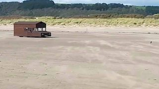 Super shed! Shed races along beach