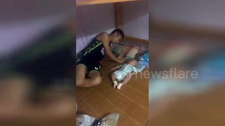 Baby mimics father's actions by rolling over - Video