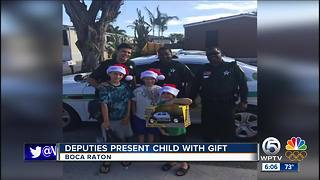 Deputies bring Christmas joy to family of boy on Autism spectrum - Video