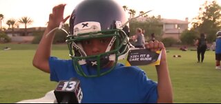Raiders give away helmets at football camp