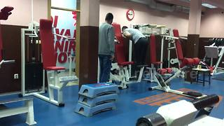 Clueless January gym newbie mounts lat pulldown machine - Video