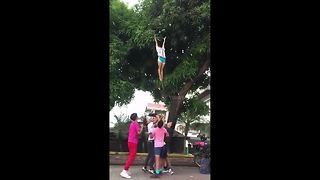 Cheerleading squad tosses friend into air to retrieve tasty mangoes - Video