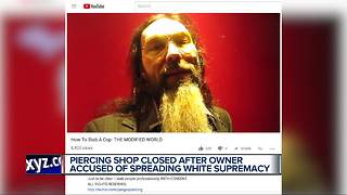 Piercing shop closed after owner accused of spreading white supremacy - Video