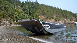 Walk the plank! Boat can climb itself up the shore with use of metal 'legs'  - Video