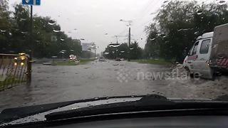 Roads turn into rivers as Russian city floods - Video