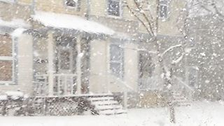 Watertown Streets Barely Visible as Heavy Snowfall Blankets City - Video