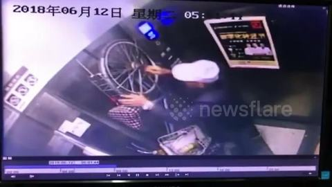 Elevator drags bicycle up after getting stuck in doors